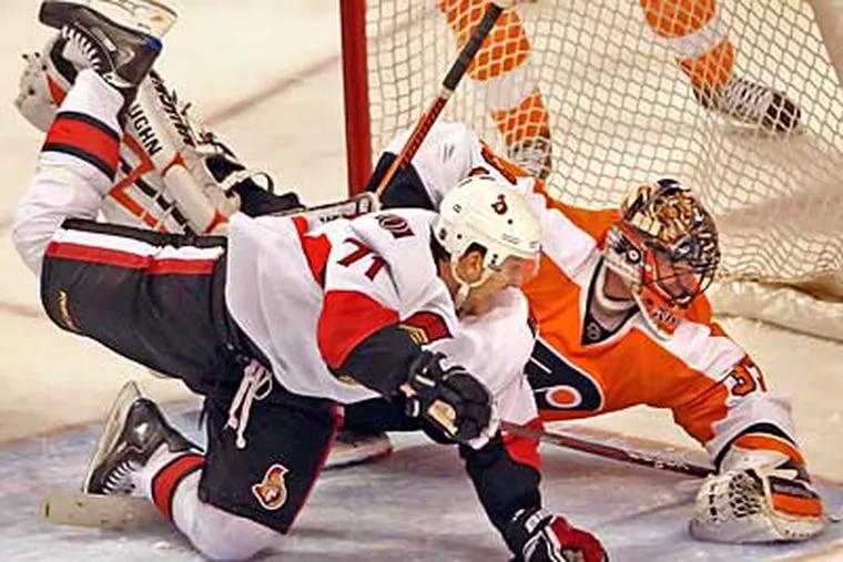 Flyers' goalie Brian Boucher can't stop the shot of Ottawa Senators' Nick Foligno during the 3rd period.  ( Steven M. Falk / Staff Photographer )