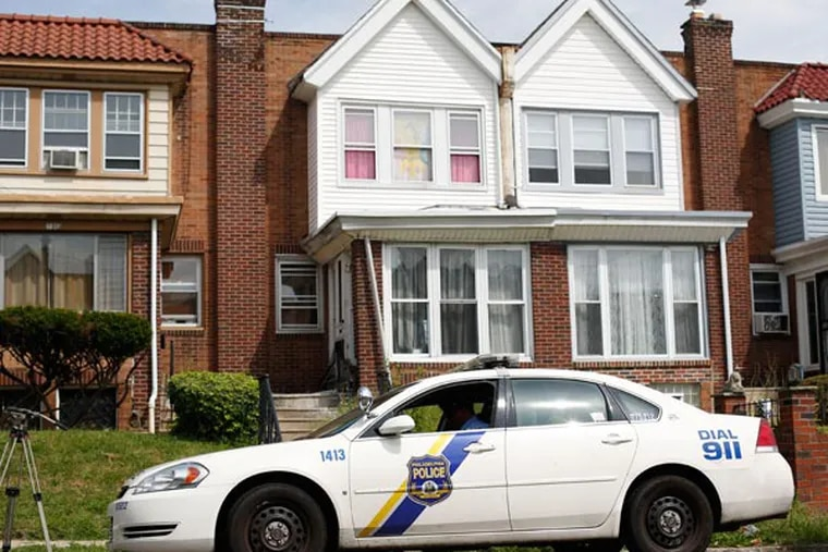 A police officer sits outside the home, center, of a 3-year-old twin who was pronounced dead at a nearby hospital, Monday, Sept. 9, 2013, in Philadelphia. Officer Jillian Russell says police are investigating the death of the girl, who was pronounced dead at Albert Einstein Medical Center just before 2 a.m. Monday. (AP Photo/Matt Rourke)