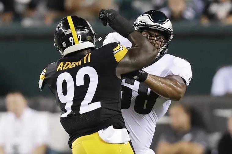 Jordan Mailata, right, blocking the Steelers' Olasunkanmi Adeniyi on Thursday.