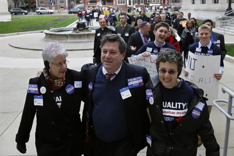 Steven Goldstein of Garden State Equality walks with supporters Marsha Shapiro, left, and Louise Walpin, right, as they lead a large group into the New Jersey Statehouse Monday, Nov. 23, 2009, in Trenton, N.J. (AP Photo/Mel Evans)
