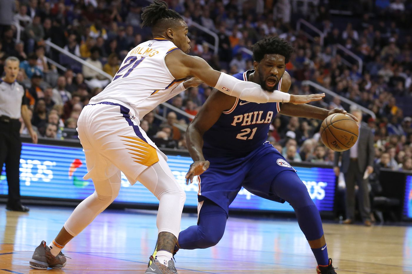 Undermanned Sixers hold off Suns, 132-127