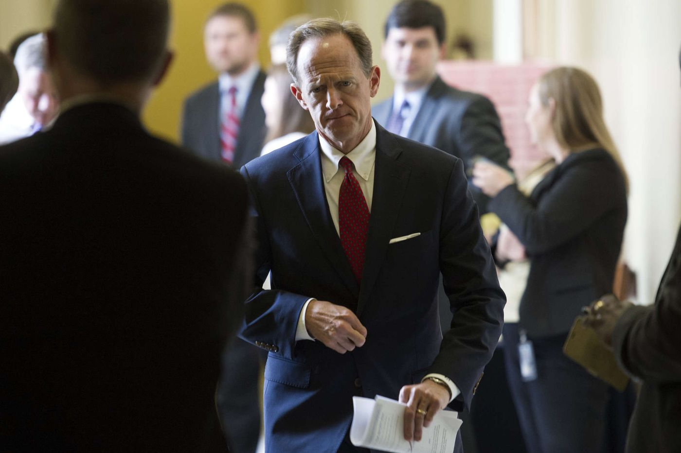 The battle over Toomey's fiscal fitness