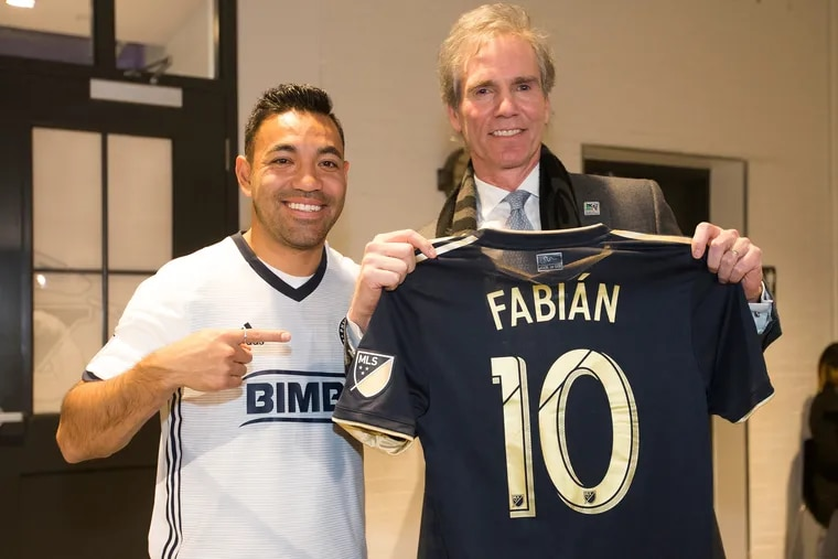 Union owner Jay Sugarman (right) at Marco Fabián's introductory press conference last February.