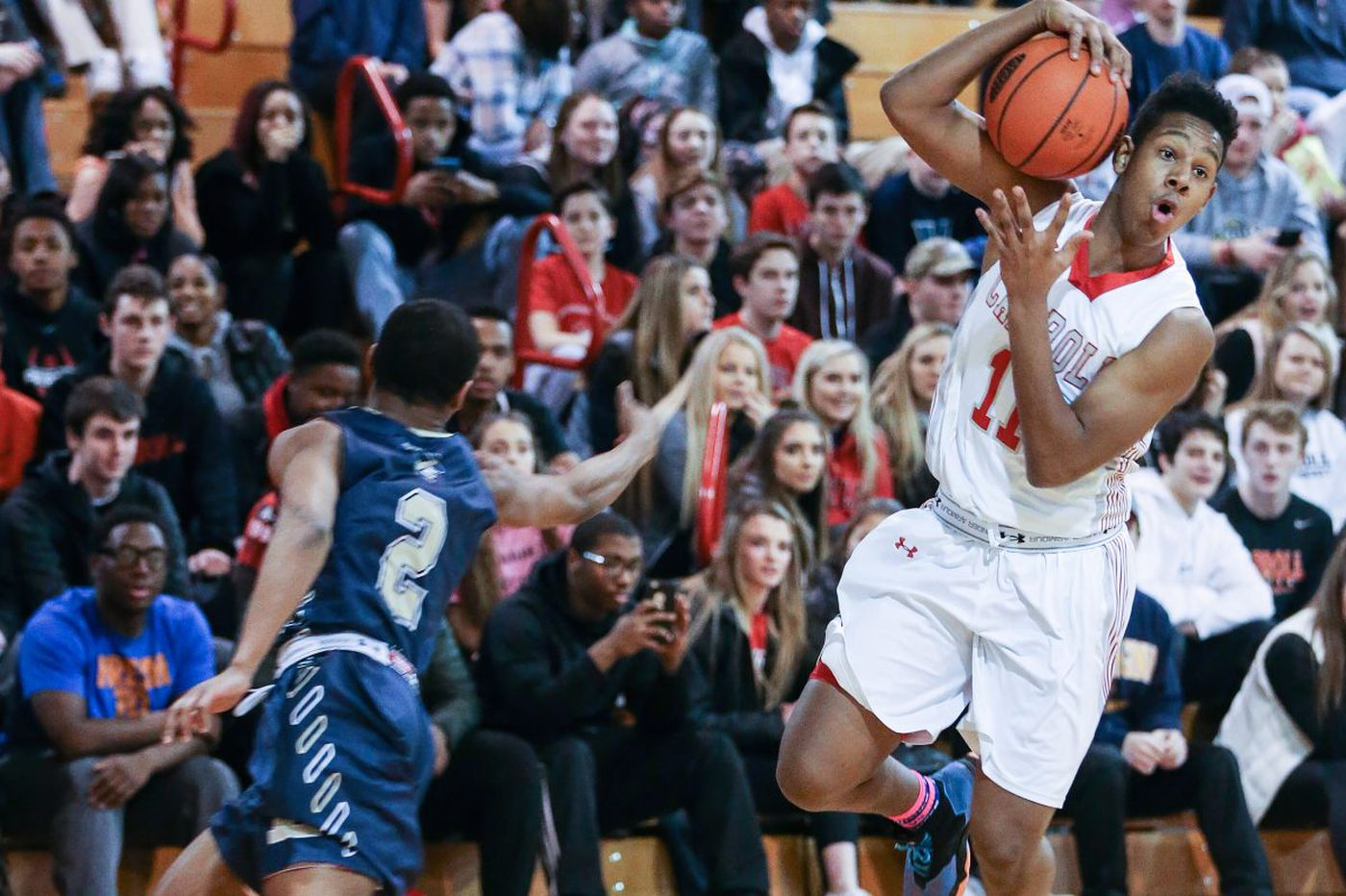 Archbishop Carroll and A.J. Hoggard roll past Archbishop Wood and back to the Palestra
