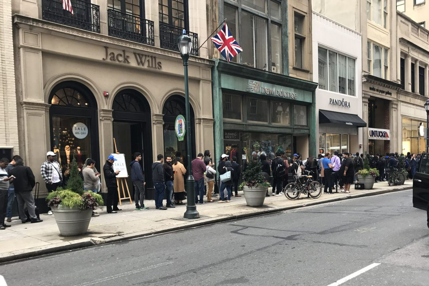 Patrons line up outside Walnut Street Apple Store for the new iPhone X