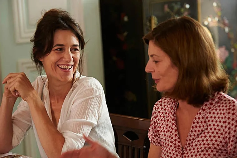"""Charlotte Gainsbourg (left) and Chiara Mastroianni in Benoît Jacquot's possibly satirical """"Three Hearts."""" (Cohen Media Group)"""