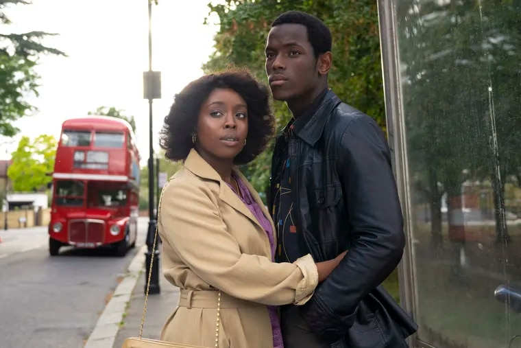 """Amarah-Jae St. Aubyn, left, and Micheal Ward in """"Lovers Rock."""" (Parisa Taghizedeh/Amazon Prime Video via AP)"""