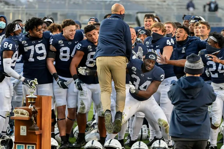 Penn State head coach James Franklin jumps into the arms of his players while celebrating the 39-24 victory over Michigan State.