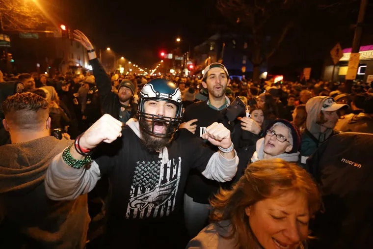 Eagles fans in South Philadelphia celebrate after the Eagles win Super Bowl LII on Feb. 4, 2018.