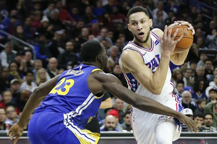 Ben Simmons, here driving past  Warriors forward Draymond Green, is putting up impressive numbers through 16 games.