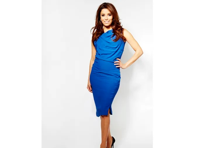 """In this Thursday, March 7, 2013 photo, chosen as the face of the new SHEBA global campaign """"Follow Your Passion,"""" actress and executive producer Eva Longoria poses for a portrait, in New York. The actress, who just wrapped a movie called ìFronteraî alongside Ed Harris and Michael Pena, is also busy behind-the-camera too as an Executive Producer on two upcoming television shows. (Photo by Dan Hallman/Invision/AP)"""