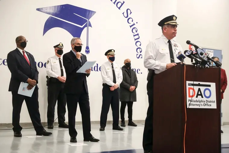 Police Chief Inspector Frank Vanore (front) and District Attorney Larry Krasner (center) during a news conference Monday about the investigation into the mass shooting that occurred Wednesday at the Broad and Olney Transportation Center in Philadelphia.