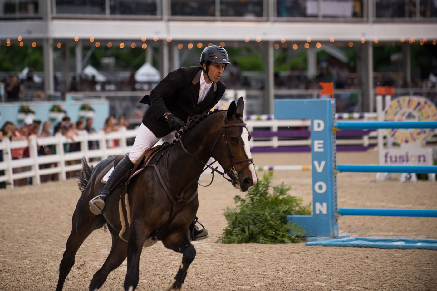 Pennsylvanian Andy Kocher races to victory in Devon Horse Show's Open Jumper Stake
