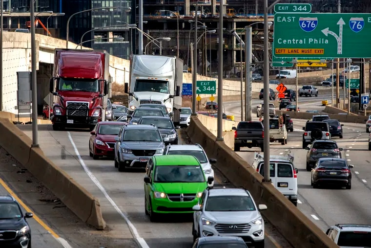 FILE - Coming off two lanes on I-676, the Vine Street Expressway,  trucks and cars merge into a single lane as they enter westbound I-76, the Schuylkill Expressway Mar. 4, 2021. Traffic congestion is a key contributor of fine particulate matter, or soot, in the city.