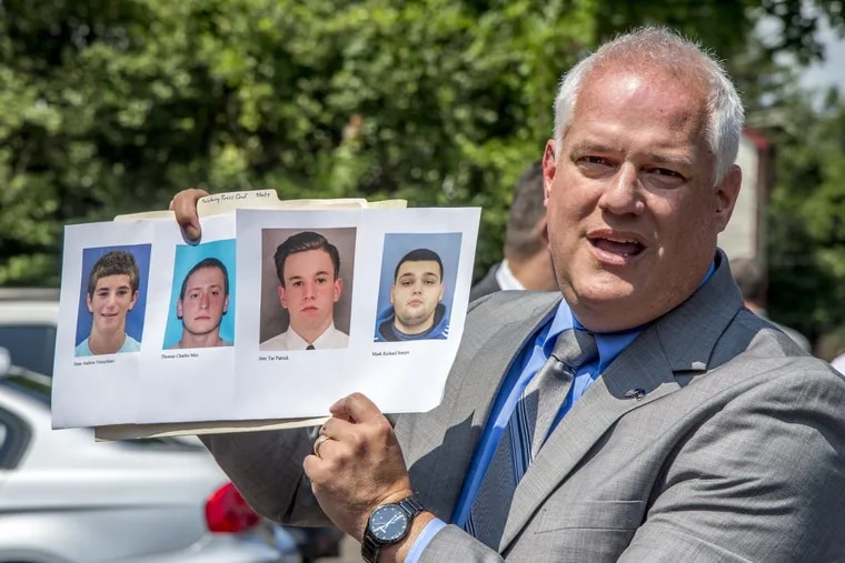 Bucks County DA Matthew Weintraub holds up photos of the slain four young men during the July search for their bodies on the DiNardo family farm in Solebury Township. The four men are (from left) Dean Finocchiaro, Thomas Meo, Jimmy Patrick and Mark Sturgis.