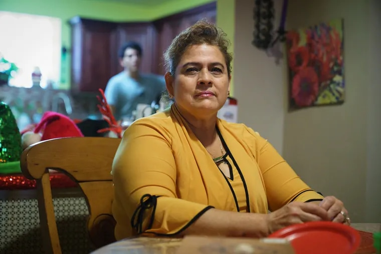 Maria Del Carmen Diaz, a professional house cleaner, shown here in her home near Girard College in Philadelphia, Monday, December 31, 2018.