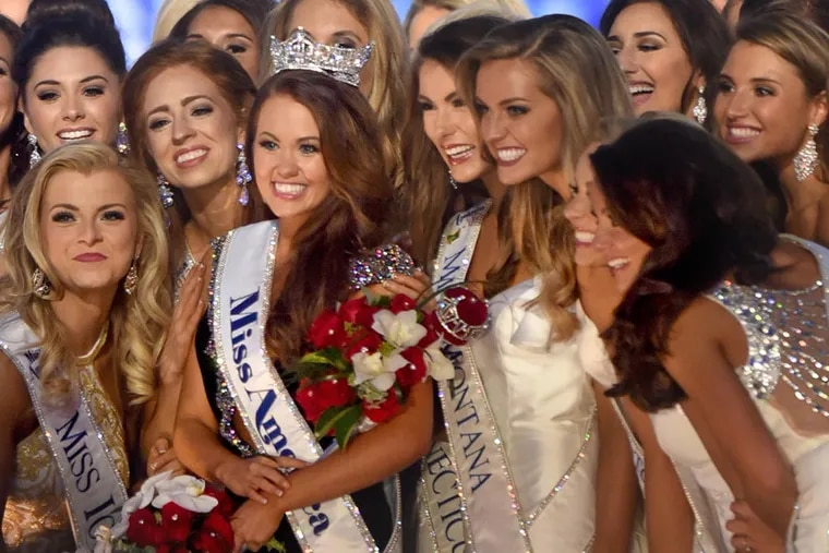 Miss North Dakota Cara Mund, is surrounded by the other contestants after winning the Miss America 2018 title in Atlantic City. The Miss America Organization sent termination letters Friday to New Jersey, New York, and Florida.