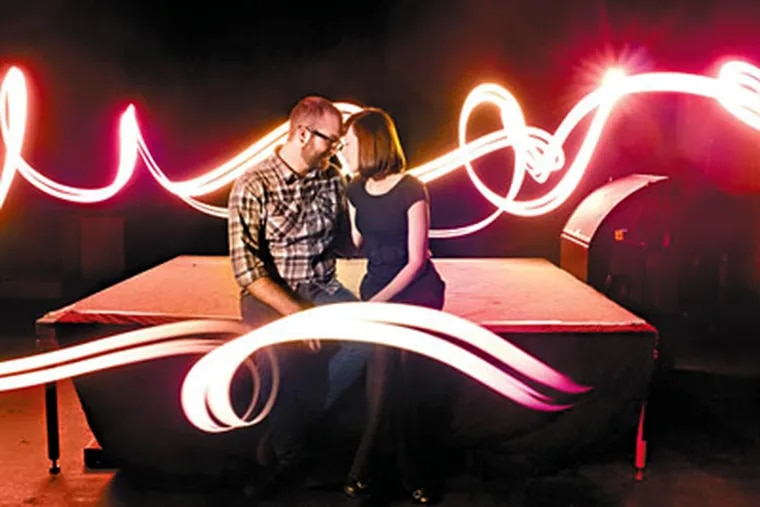 The engagement photos of Byron Armstrong & Amanda Czerniak were taken at the Trocadero Theater where they met. (Mike Allebach / Allebach Photograph)