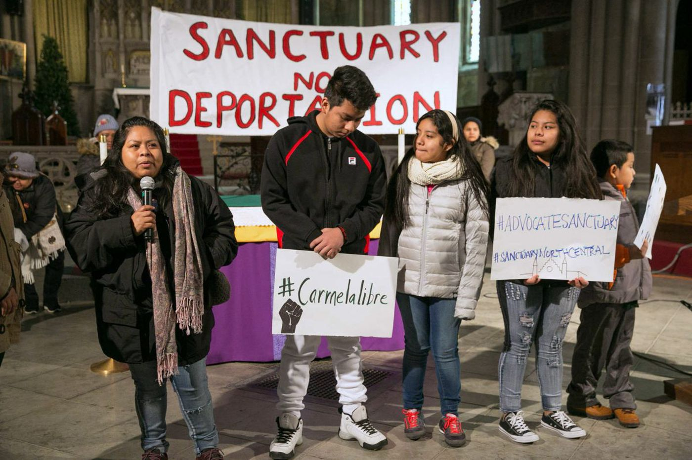 Undocumented immigrant mother, four children claim sanctuary in North Philly church
