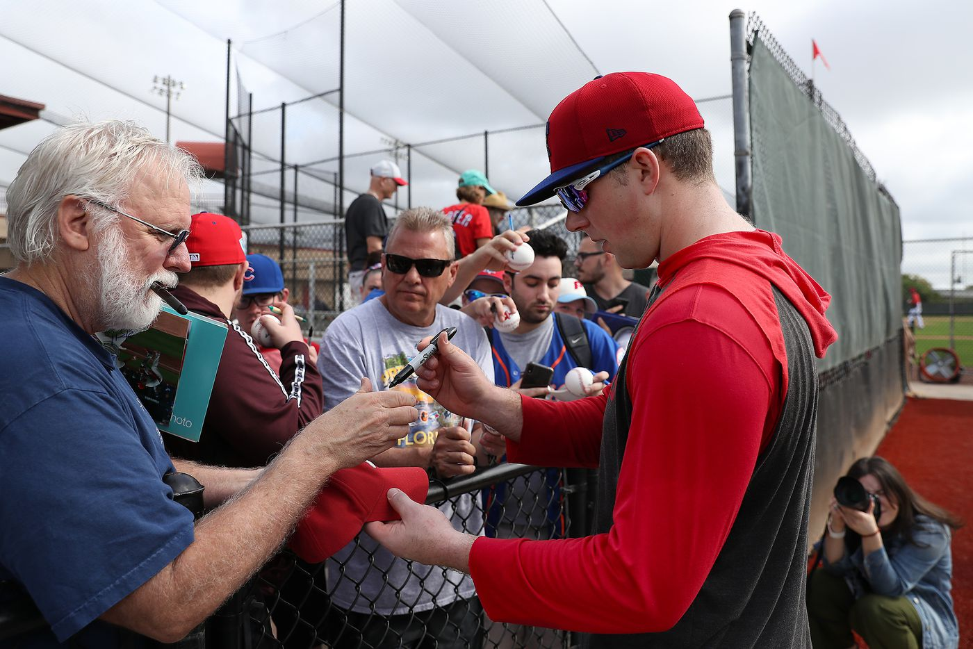 Rhys Hoskins signs autographs during Phillies spring training in Clearwater, Fla. on Feb. 14.