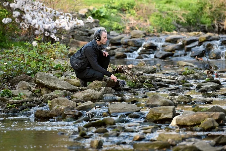 Musician and sound designer Michael Reiley records sound in the wild along the Wissahickon Creek April 9, 2020. He has created Echozoo, in which he manipulates field recordings of modern animals to create soundscapes that imagine the sounds made by long-extinct animals and their environments.