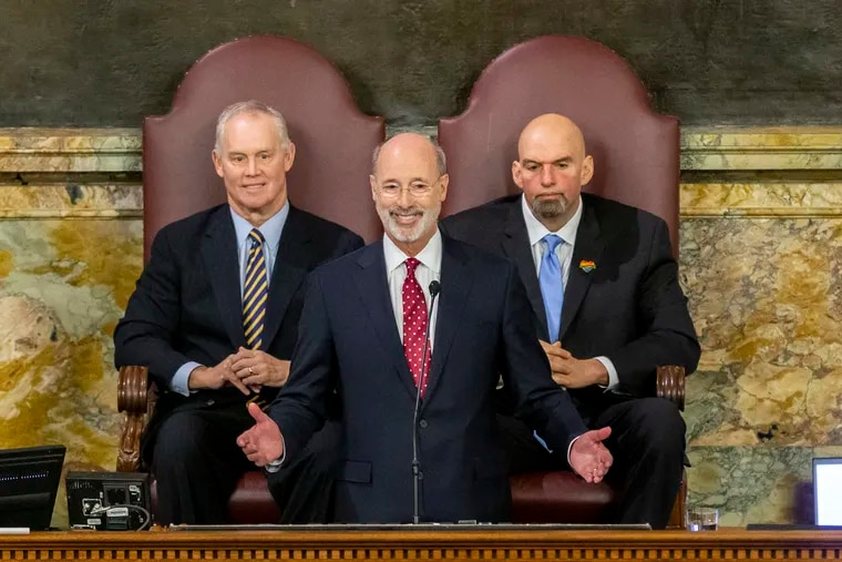 Pennsylvania Gov. Tom Wolf delivers his 2020-21 budget address in the state House of Representatives as Speaker Mike Turzai, left, and Lt. Gov. John Fetterman, right, look on, on Feb. 4, 2020, in Harrisburg, Pa.