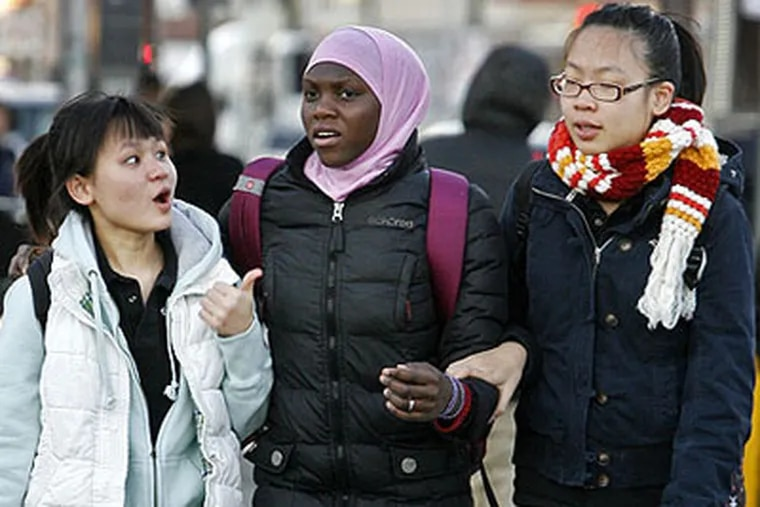 Two Asian girls and a black friend embrace after seeing each other the morning boycotting students returned to South Phila. High. They said they were part of the boycott. ALEJANDRO A. ALVAREZ / PHILADELPHIA DAILY NEWS