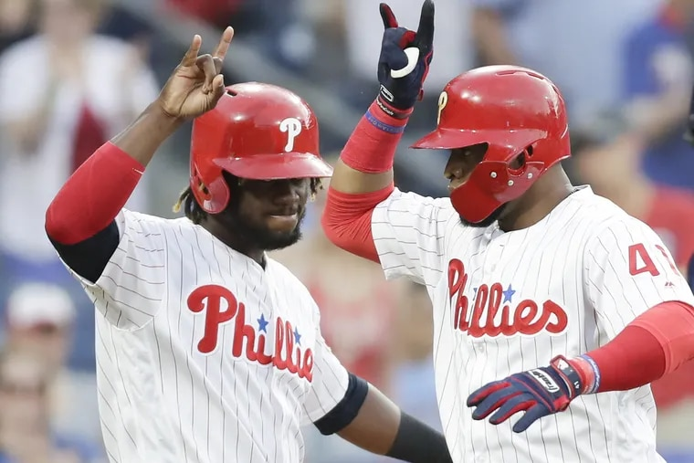 Phillies first baseman Carlos Santana celebrates his second-inning three run home run with teammate Odubel Herrera against the San Diego Padres on Friday.