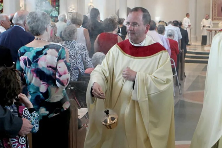 Msgr. Joseph McLoone at the 2013 dedication of a new church building at St. Joseph Parish in Downingtown.