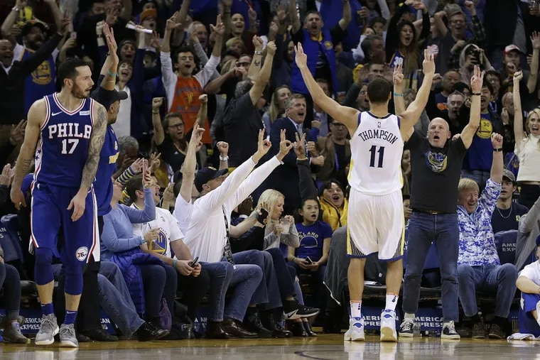 Warriors guard Klay Thompson (right) celebrates during the Sixers' loss on Saturday.