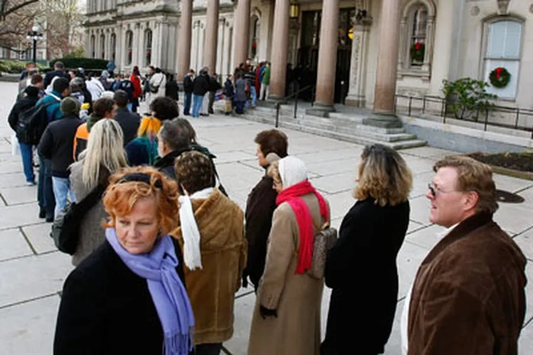 People wait in line to go into the New Jersey Statehouse Monday, Dec. 7, 2009, in Trenton, N.J. (AP Photo/Mel Evans)