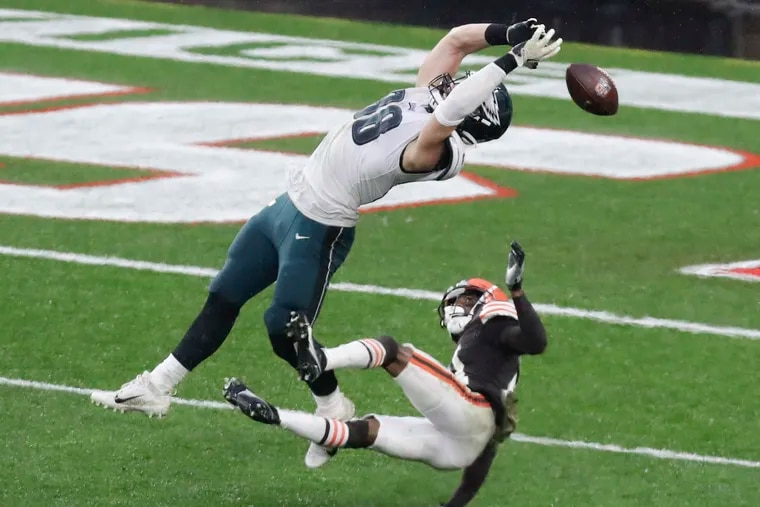 Eagles tight end Dallas Goedert attempts to catch the football against Cleveland Browns cornerback Denzel Ward during the fourth quarter on Sunday, November 22, 2020.  Ward committed a pass interference penalty on the play.