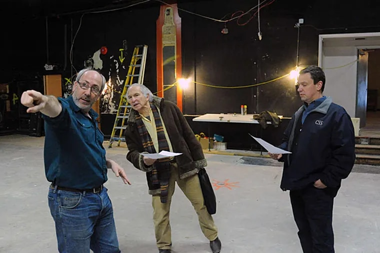 Rozin gives a tour of the Drake space, which is undergoing extensive renovations, to Michael Coleman (center) and Bill Kiesling, who are planning a new theater company. (CLEM MURRAY / Staff Photographer)