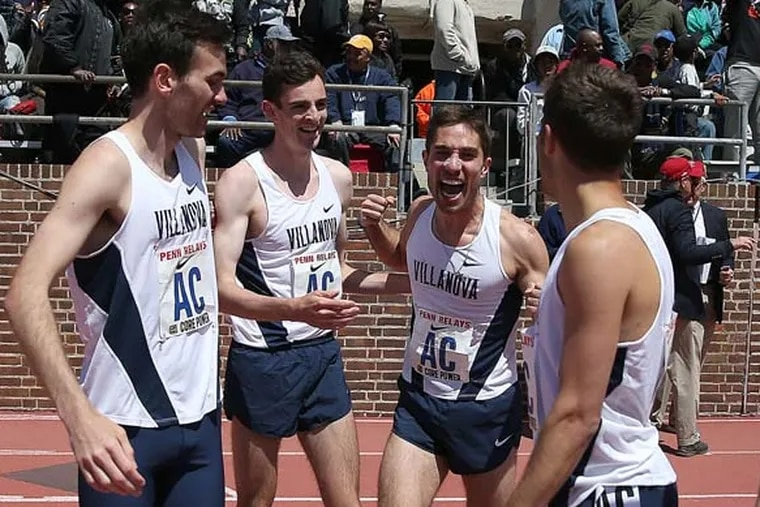 Patrick Tiernan (second from left) celebrates with his teammates after winning the college men's 4xmile relay at the 2015 Penn Relays. With him are Sam McEntee (left), Jordy Williamsz (second from right), and Rob Denault.