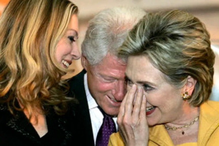 The Clintons (left) share a laugh in Ponce, Puerto Rico, yesterday after Sen. Hillary Clinton spoke to union members. Sen. Barack Obama, meanwhile, was chatting with veterans in Las Cruces, N.M.