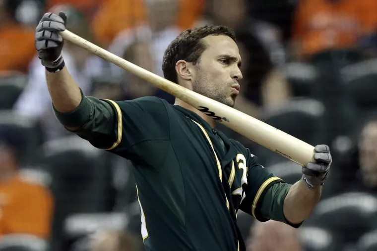 Sam Fuld, then with Oakland, warms up during a September 2015 game.