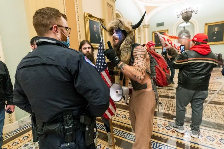 Jacob Anthony Chansley, in the horned headdress, left a note for the vice president indicating the insurrectionists in last week's Capitol riot intended to capture and assassinate lawmakers, prosecutors said.