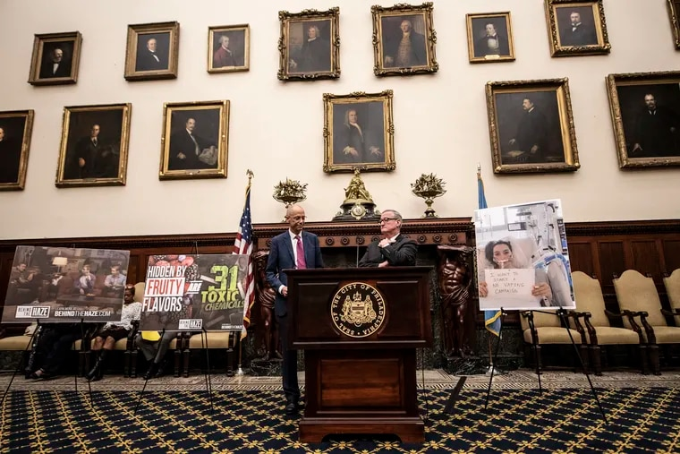 Jim Kenney, Mayor of Philadelphia and Philadelphia Health Commissioner Thomas Farley, left, speak during a press conference that announced the legislation to introduce ban sales of e-cig devices and high-nicotine and flavored pods in shops that serve customers under 18. They spoke to city official and the media at Philadelphia City Hall on Wednesday, October 16, 2019.