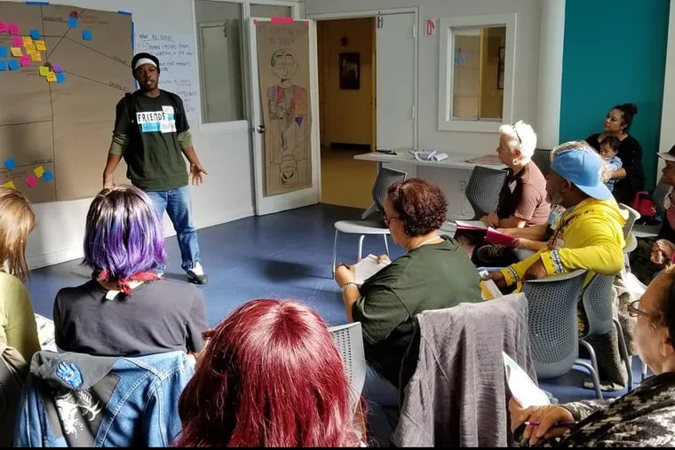 Friends of the Library member Josh Mitchell explains proposed improvements to local branches at a Nov. 3 meeting in North Philadelphia.