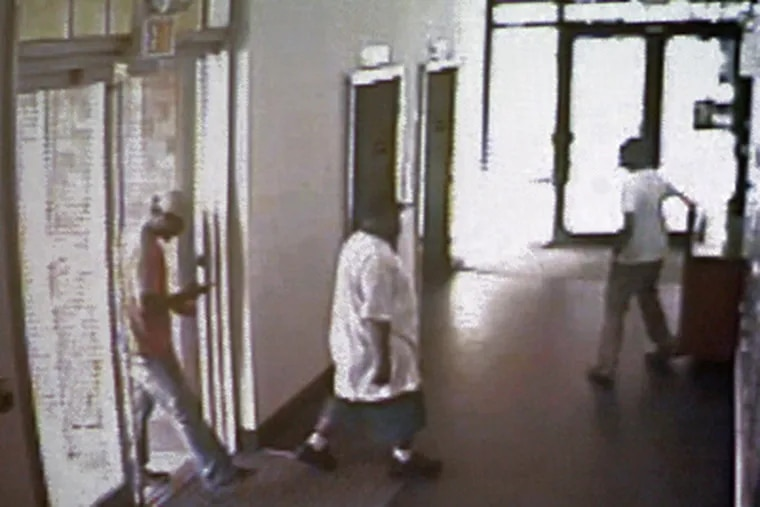 Surveillance video shows the three suspects in the murder of Rian Thal and Timothy Gilmore at the Navona apartment building in the Piazza at Schmidts complex on Saturday.