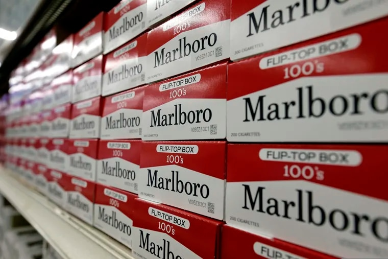 Cartons of Marlboro cigarettes on the shelves at JR Cigar Outlet in Burlington, N.C. Sen. Dick Durbin (D., Ill.) and other congressional Democrats introduced legislation to establish the first federal e-cigarette tax and increase the tobacco tax rate.