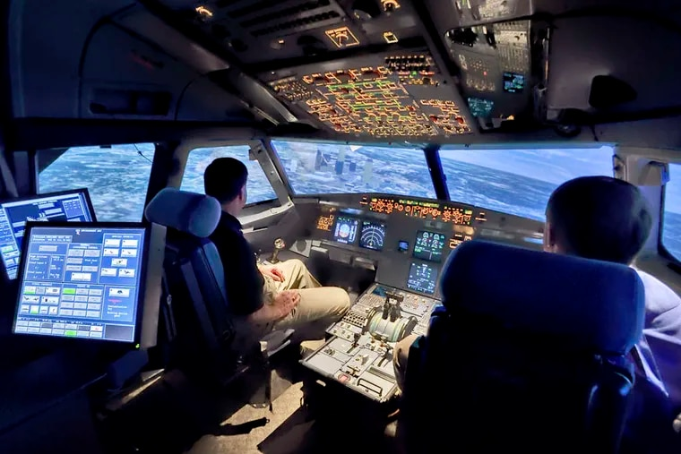 An Airbus A320 flight simulator. U.S. rules mandate two people in a cockpit at all times during commercial flights. The captain of the Germanwings Airbus A320 that crashed in the Alps had left the cockpit before the copilot barricaded himself in.