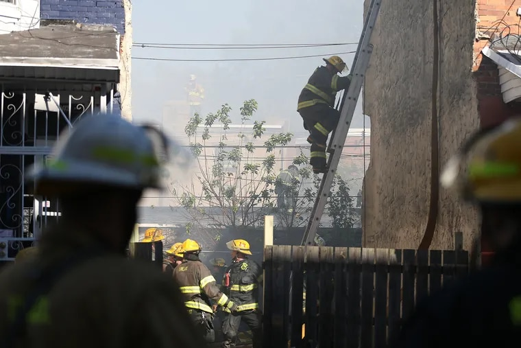Firefighters battle a two-alarm fire in the Harrowgate section of city that destroyed several on Monday, October 22, 2018.