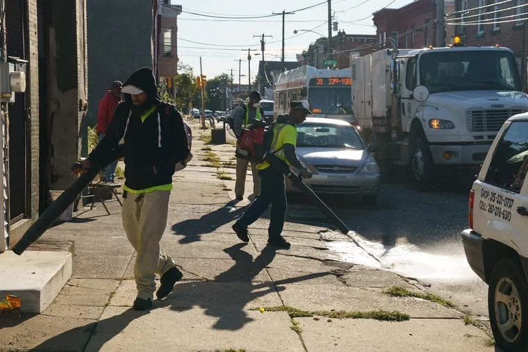 A street sweeping crew works near at 24th and York.