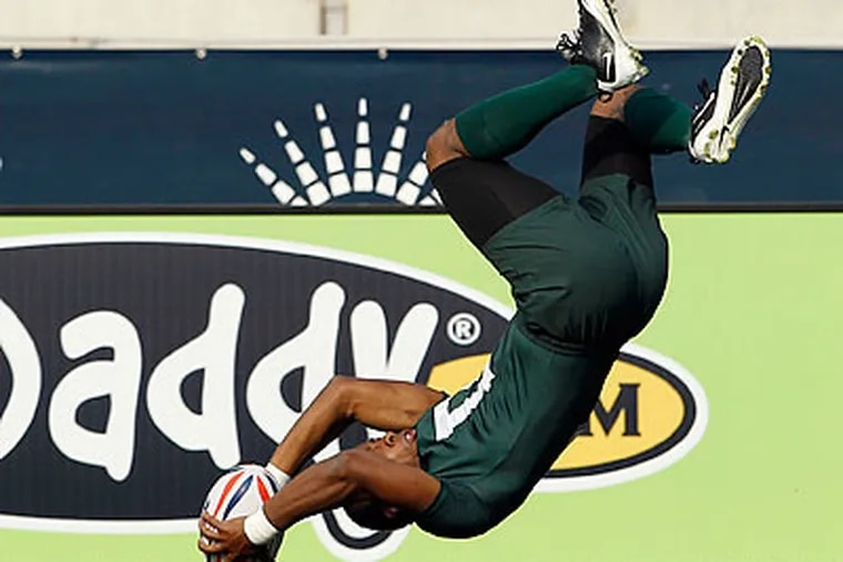 Dartmouth's Muhammed Adbul-Shakkor went head-over-heels to score this try against Army. (Yong Kim/Staff Photographer)