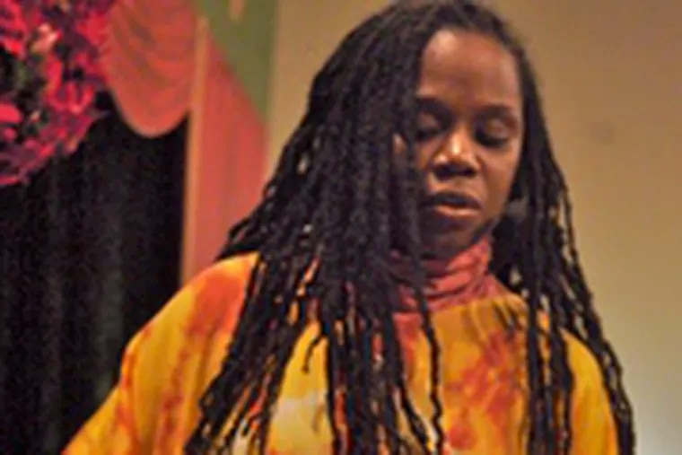 and other Kwanzaa traditions are explained toa Cherry Hill audience bya Delaware artist named TAHIRA.