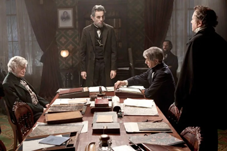 """FILE - This undated publicity photo released by DreamWorks and Twentieth Century Fox shows, Daniel Day-Lewis, center rear, as Abraham Lincoln, in a scene from the film, """"Lincoln."""" (AP Photo/DreamWorks, Twentieth Century Fox, David James, File)"""
