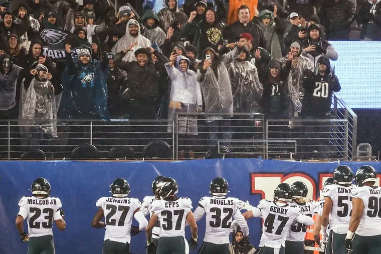 The Eagles defense celebrates and poses for photos after a Sidney Jones interception in the fourth quarter against the Giants on Sunday.