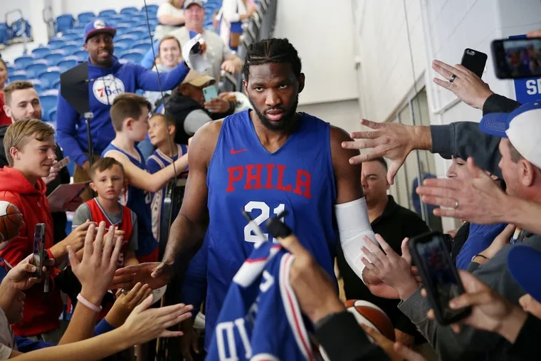 Joel Embiid greets fans before the Sixers' annual Blue and White Scrimmage on Saturday.