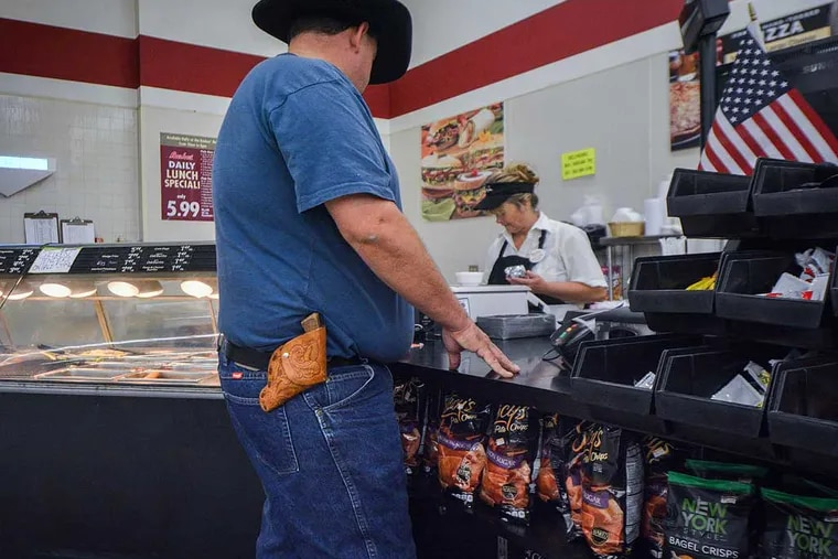 Lee Bird carries his .38-caliber pistol on his hip everywhere he goes. That includes his local grocery store in Wickenburg, Ariz. Photo by Jacob Byk/News21.